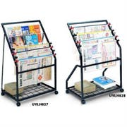 Magazine and News Paper Holder with black steel frame and four swivel wheels. Two wire shelves for magazines and four newspaper organizers -- 1 each.